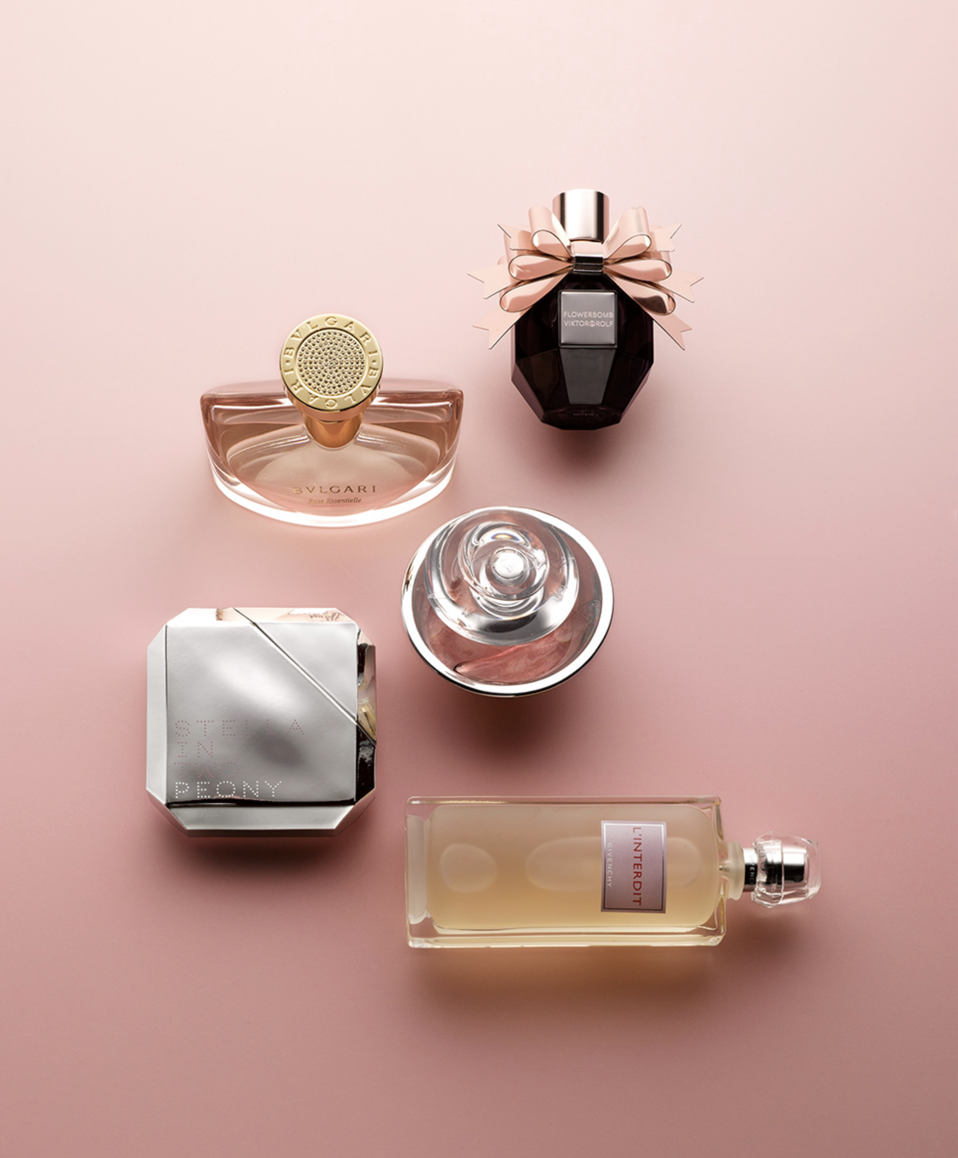 perfumes on pink